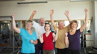 Group of elderly people having fun in gym